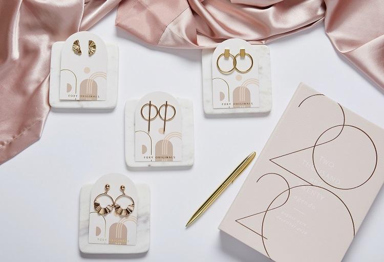 win gold earrings